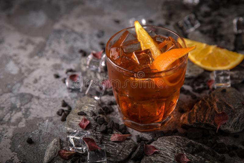 Alcoholic or non-alcoholic cocktail with orange citrus, pomegranate with the addition of liqueur, vodka, champagne or martini. Cool drink. Easy Bartenders royalty free stock image