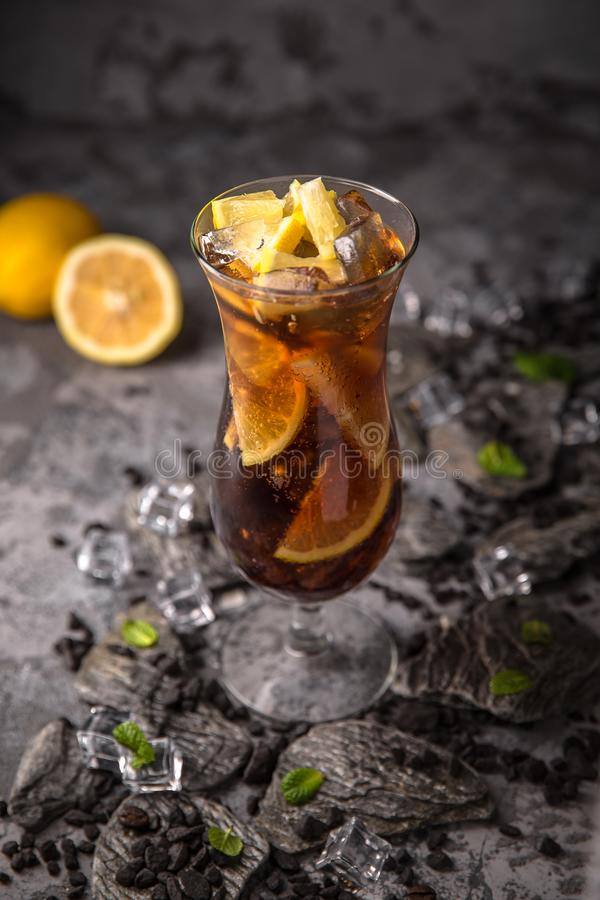 Alcoholic or non-alcoholic cocktail with orange citrus, pomegranate with the addition of liqueur, vodka, champagne or martini. Cool drink. Easy Bartenders royalty free stock photo