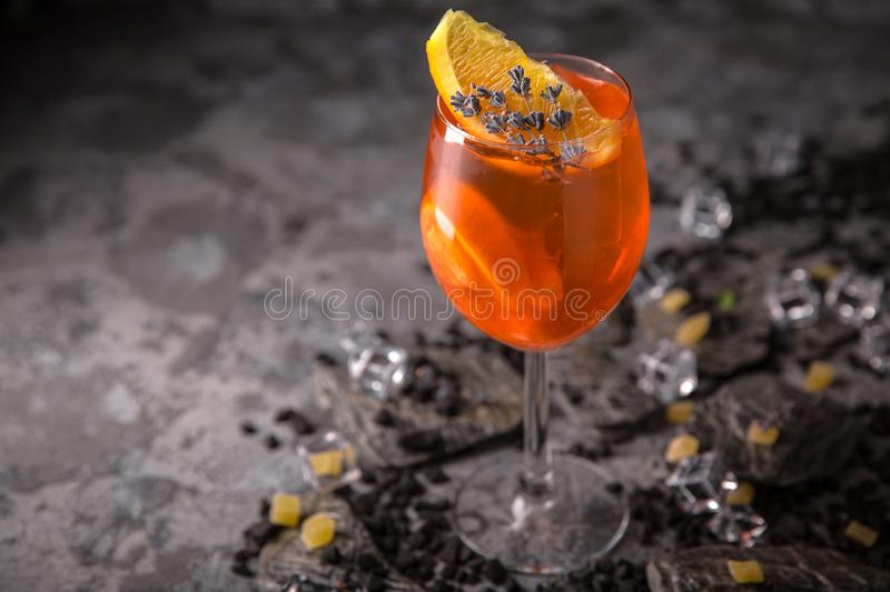Alcoholic or non-alcoholic cocktail with orange citrus, pomegranate with the addition of liqueur, vodka, champagne or martini. Cool drink. Easy Bartenders royalty free stock images