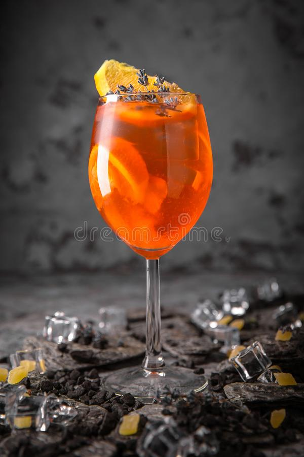 Alcoholic or non-alcoholic cocktail with orange citrus, pomegranate with the addition of liqueur, vodka, champagne or martini. Cool drink. Easy Bartenders royalty free stock photography