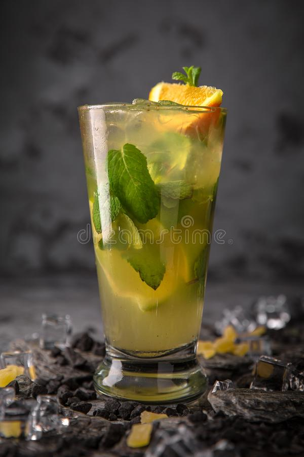 Alcoholic or non-alcoholic cocktail with orange citrus, pomegranate with the addition of liqueur, vodka, champagne or martini. Cool drink. Easy Bartenders stock image