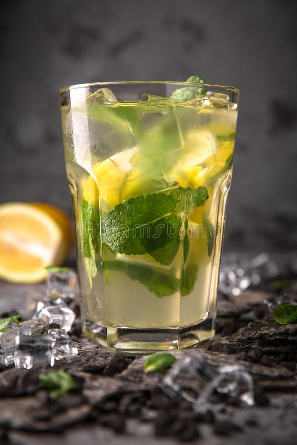 Alcoholic or non-alcoholic cocktail with orange citrus, pomegranate with the addition of liqueur, vodka, champagne or martini. Cool drink. Easy Bartenders stock photo