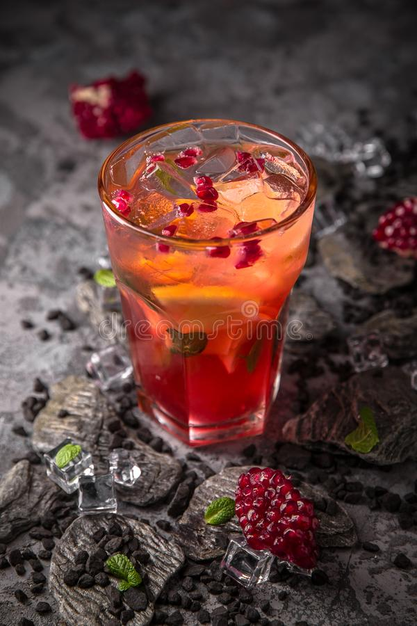 Alcoholic or non-alcoholic cocktail with orange citrus, pomegranate with the addition of liqueur, vodka, champagne or martini. Cool drink. Easy Bartenders stock photography