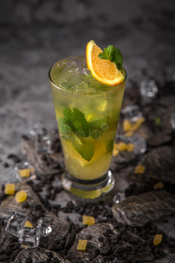 Alcoholic or non-alcoholic cocktail with orange citrus, pomegranate with the addition of liqueur, vodka, champagne or martini. Cool drink. Easy Bartenders stock photos