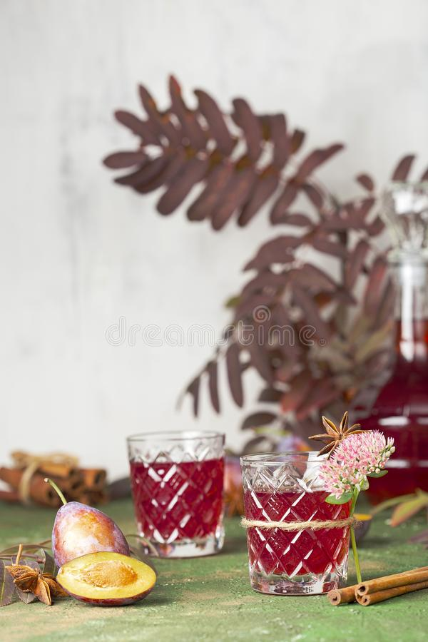 Alcoholic plum tincture. With star anise, cinnamon and cloves royalty free stock images