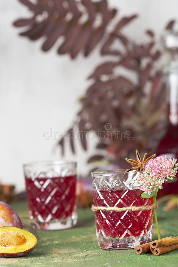 Alcoholic plum tincture. With star anise, cinnamon and cloves stock photo