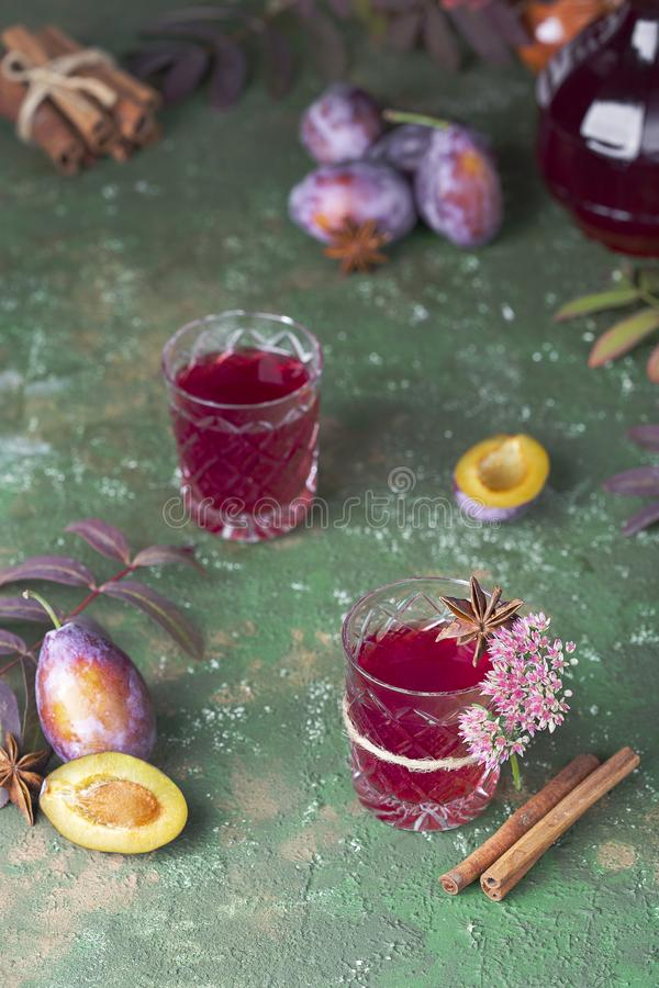 Alcoholic plum tincture. With star anise, cinnamon and cloves stock image