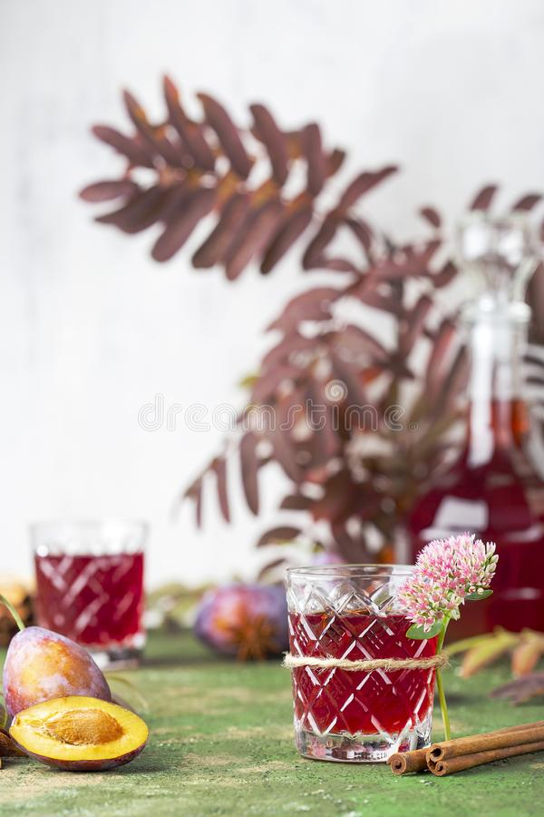 Alcoholic plum tincture. With star anise, cinnamon and cloves royalty free stock photography