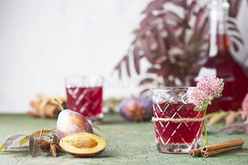 Alcoholic plum tincture. With star anise, cinnamon and cloves stock photography