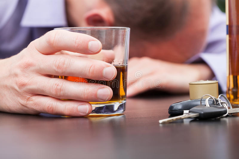 Alcoholic sleeping on the table stock photo