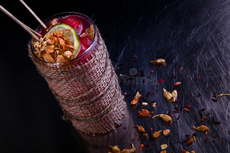 Alcoholic winter recreational cocktail. Black background royalty free stock photos