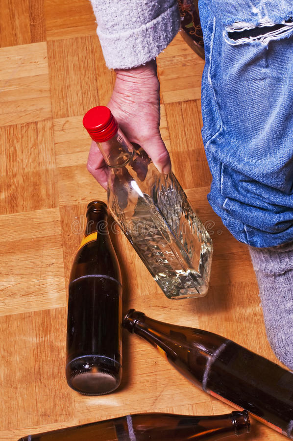Alcoholism. A scene with bottles of beer and liquor royalty free stock image