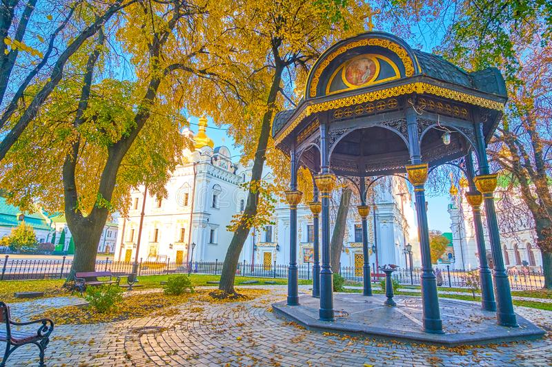 The alcove in Kiev Pechersk Lavra, Ukraine. The scenic metal alcove with the drinking fountain locate din the courtyard of Kiev Pechersk Lavra, Ukraine stock photo