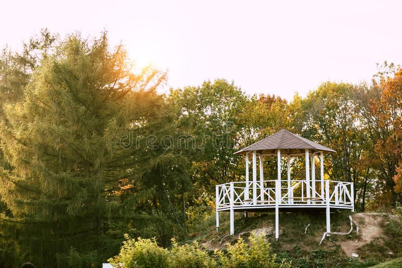 Alcove near lake in beautiful. Autumn park royalty free stock images