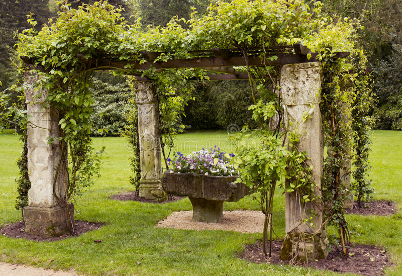 Alcove with vase of flowers in the Garden. Alcove vase of flowers in the Garden stock images
