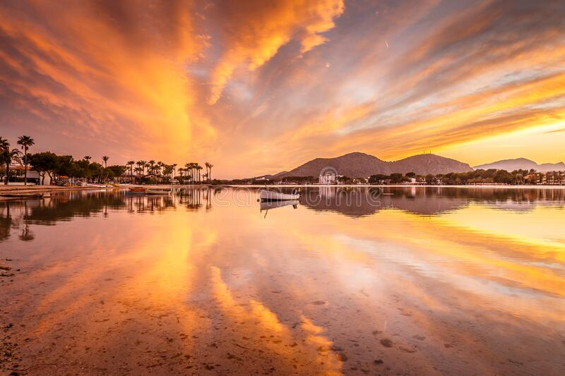 Amazing sunset and reflections at Puerto Alcudia, Mallorca stock image
