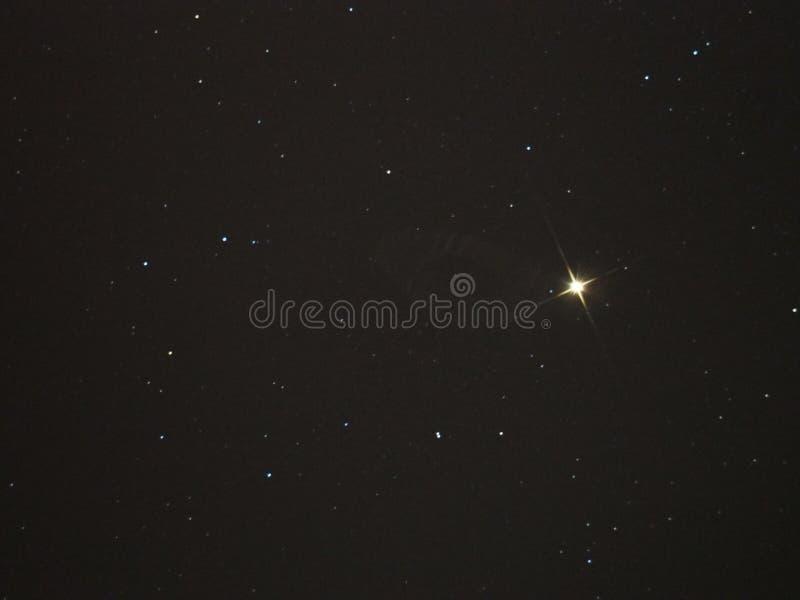 Night sky stars, Aldebaran star. In Taurus constellation royalty free stock photography