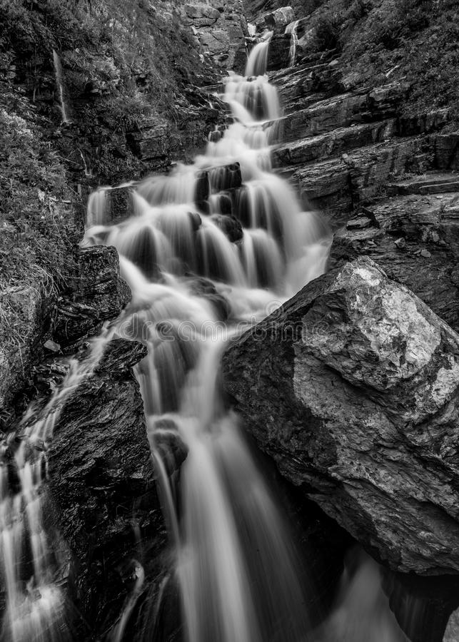 Alder Creek Falls Black and White. Tumbling over a rock cliff royalty free stock photos