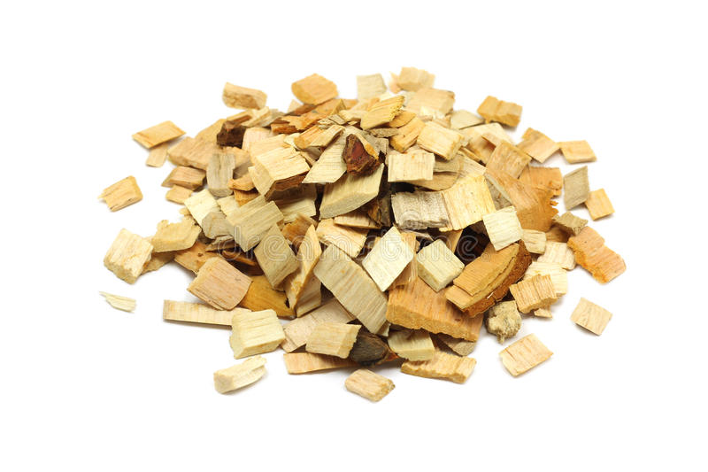 Alder wood chips for smoking. On a white background royalty free stock images