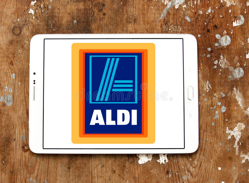 Aldi logo. Logo of aldi chain stores on samsung tablet on wooden background stock photos