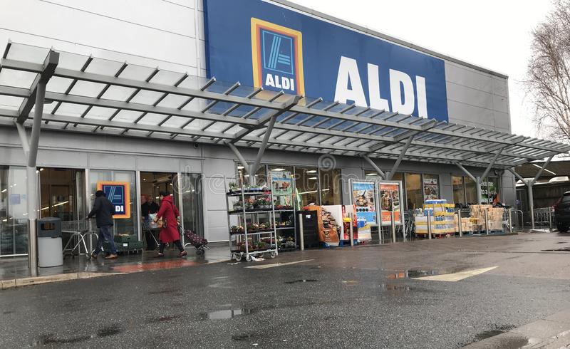 Aldi store. Aldi stylised as ALDI is the common brand of two German family owned discount supermarket chains with over 10,000 stores in 20 countries, and an stock photography