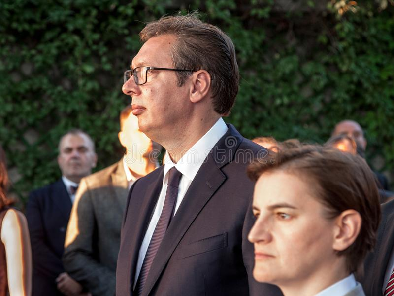 Aleksandar Vucic, President of Serbia listening to speech at French embassy near PM Ana brnabic. Picture of Aleksandar Vucic and Ana brnabic, respectively stock photography