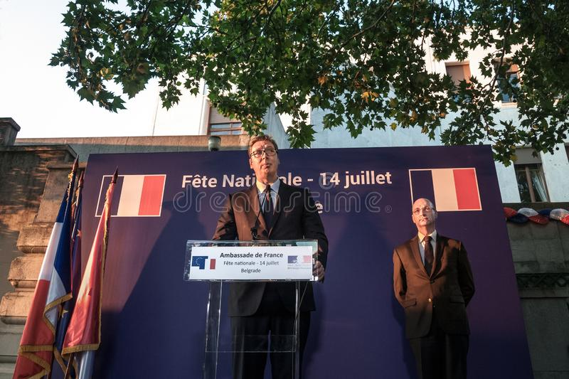 Aleksandar Vucic, President of Serbia standing and making a speech at the French embassy with French Embassador Frederic Modoloni. NPicture of Aleksandar Vucic stock image