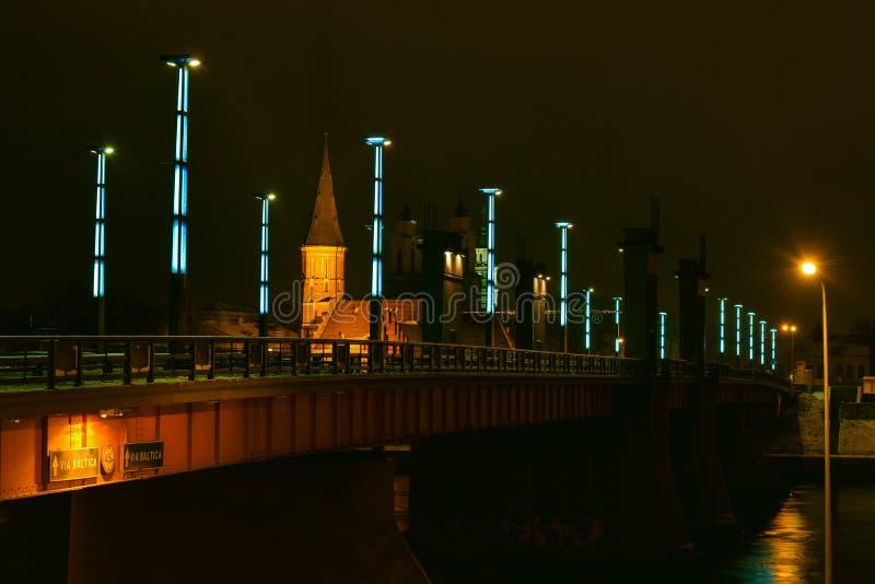 Aleksotas bridge night view Kaunas Lithuania. Night view of the illuminated Vytautas the Great bridge in Aleksotas, Kaunas, Lithuania royalty free stock image