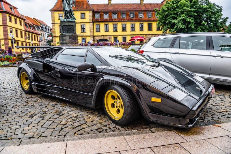 ALEMANHA, FULDA - EM JULHO DE 2019: LAMBORGHINI preto COUNTACH é um meados de-motor traseiro, carro de esportes da tração traseir imagem de stock royalty free