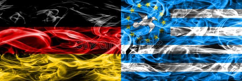 Alemania contra las banderas del sur del humo del Camerún colocadas de lado a lado Germa fotografía de archivo