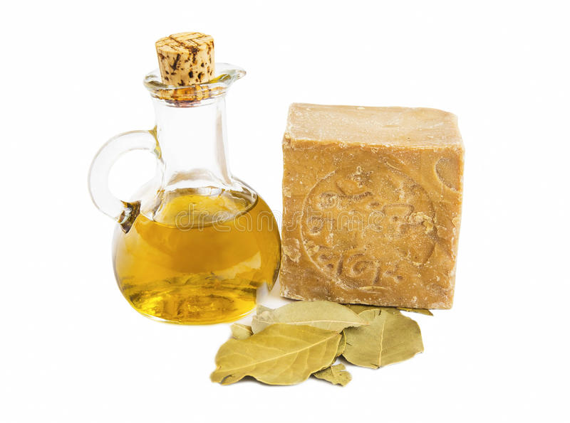 Alep soap with olive oil and bay leaves. Alep soap with olive oil bottle and bay leaves isolated royalty free stock images
