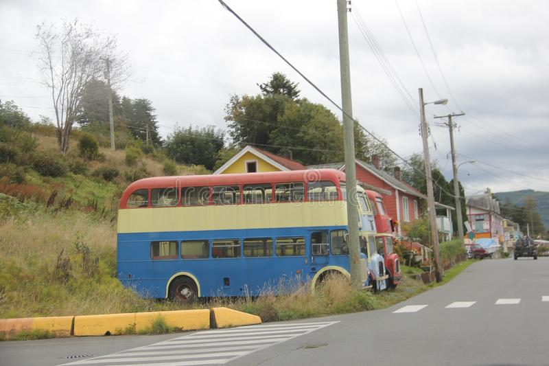 Colorful old Double Decker buses Alert Bay, BC. Alert Bay is a village on Cormorant Island, in the Regional District of Mount Waddington, British Columbia stock image