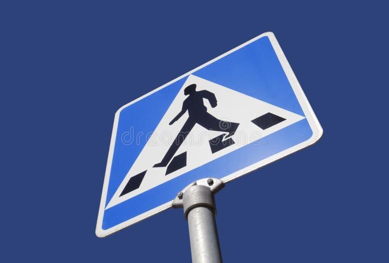 Alert walk sign. Photo of a alert walk sign against blue sky stock photos