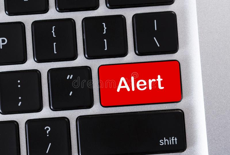 Alert word on red computer keyboard button royalty free illustration