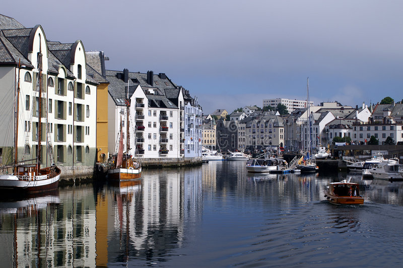 Alesund city. Houses of Alesund reflected in the water of the harbour royalty free stock photo