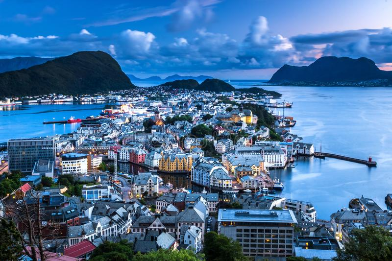 City Scene with Aerial View of Alesund Center during Blue Hour. Image of Alesund after midnight in Summer taken from Mount Aksla Viewpoint. Alesund is a port royalty free stock photo