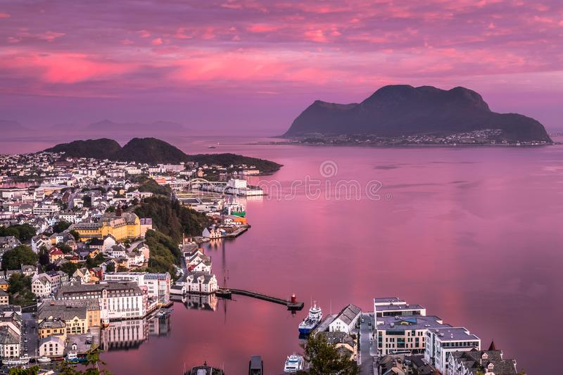 Breathtaking Alesund at Pink Sunrise. The photo was taken at a breaking dawn from Mount Aksla viewpoint in Alesund, More og Romsdal County, Norway in Summer royalty free stock photography