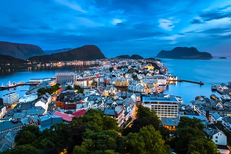 City Seascape with Aerial View of Alesund Center during Blue Hour. Image of Alesund after midnight in Summer taken from Mount Aksla Viewpoint. Alesund is a port royalty free stock image