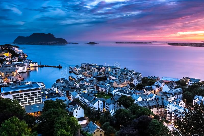 Alesund after Sunset at Midnight in Summer. This photo was taken after midnight in Summer in Alesund, More og Romsdal County, Norway. Alesund is a port town on royalty free stock images