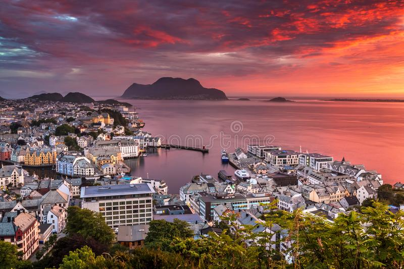 City Seascape with Aerial View of Alesund Center, Islands and Atlantic Ocean at Gorgeous Sunset. Image of Alesund at sunset in Summer taken from Mount Aksla stock photo