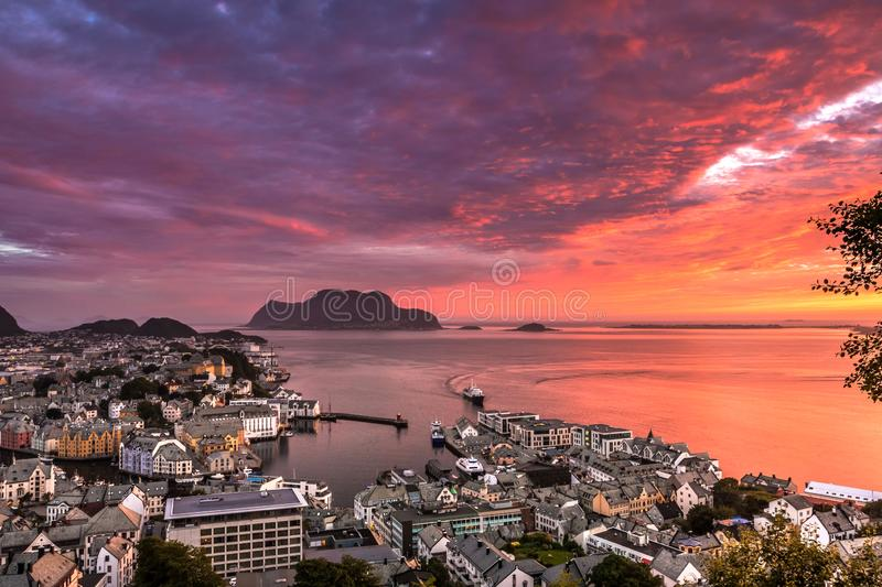City Seascape with Aerial View of Alesund Center, Islands, Atlantic Ocean and Colorful Sky at Gorgeous Sunset. Image of Alesund at sunset in Summer taken from stock photo