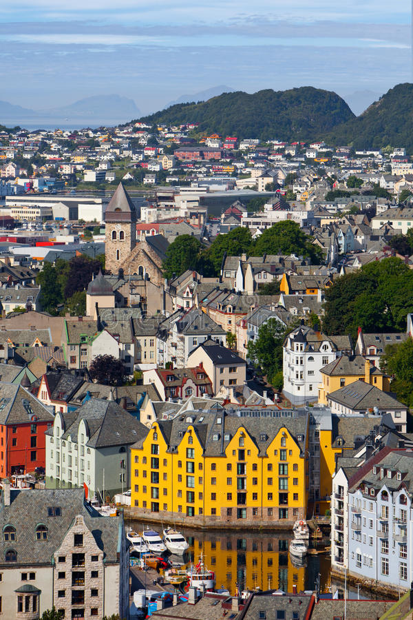 Alesund, Norway. A beautiful view on Alesund from a high hill overlooking the buildings and river of Alesund, a seaport in Norway, known for its outstanding royalty free stock image