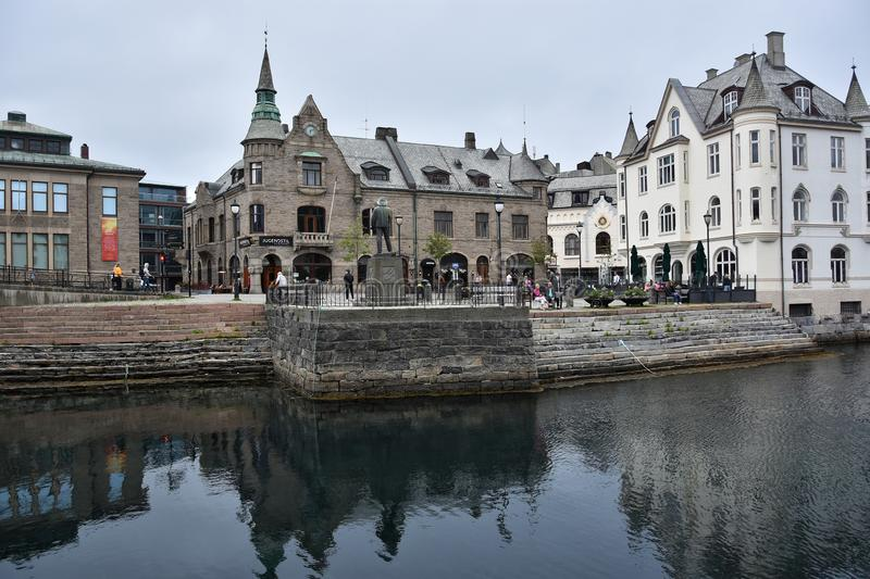Alesund town and port, More og Romsdal, Norway. ALESUND, NORWAY - JULY 6, 2018. View of Art Nouveau Centre in Alesund town and port, More og Romsdal , on the royalty free stock photos