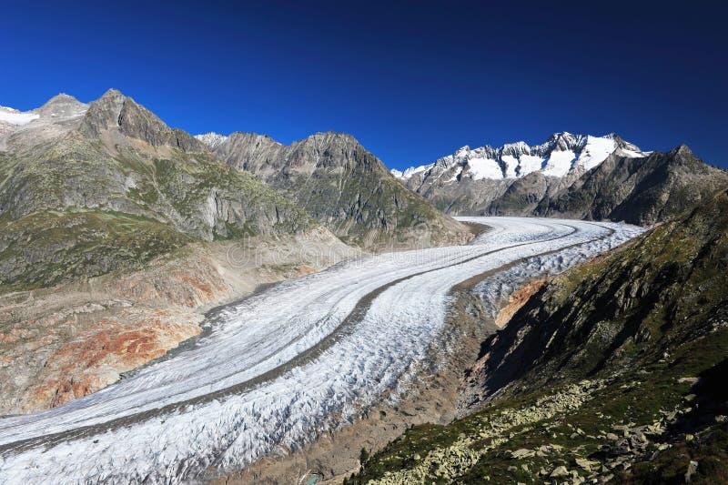 Aletsch Glacier. And the summits of Fiescher Gabelhorn, Schönbühlhorn, Wannenhorn in Valais, Switzerland, on a bright morning stock photography