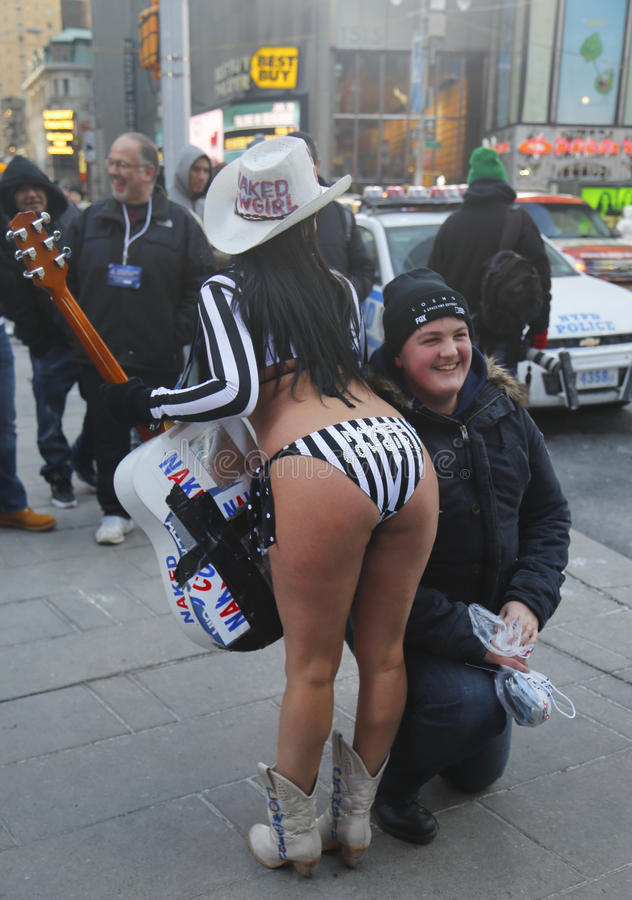 Alex, the Naked Cowgirl, entertains the crowd in Times Square during Super Bowl XLVIII week in Manhattan stock image