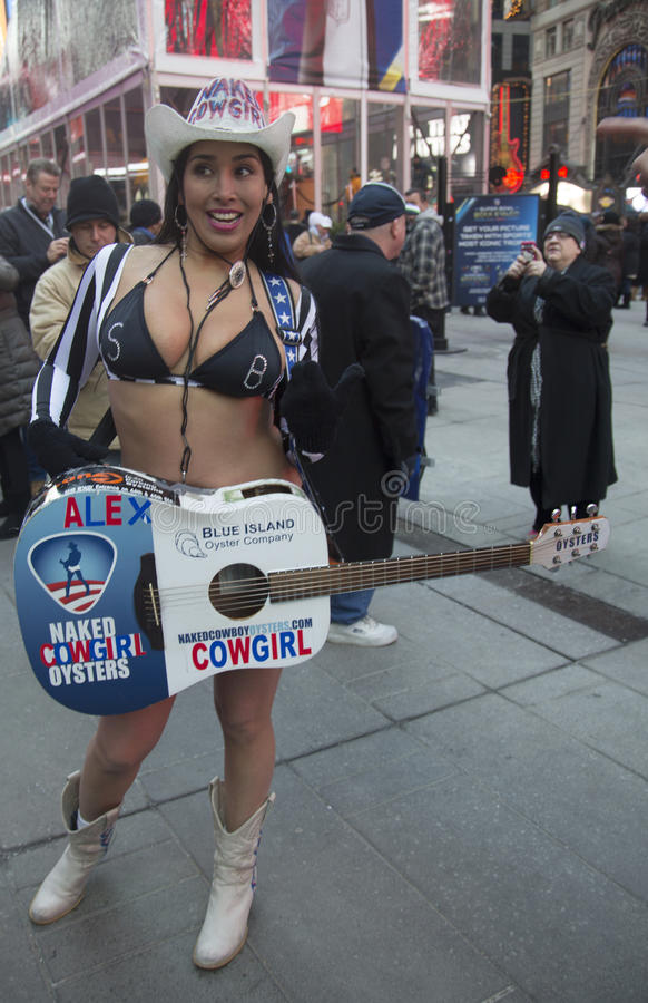 Alex, the Naked Cowgirl, entertains the crowd in Times Square during Super Bowl XLVIII week in Manhattan royalty free stock photos