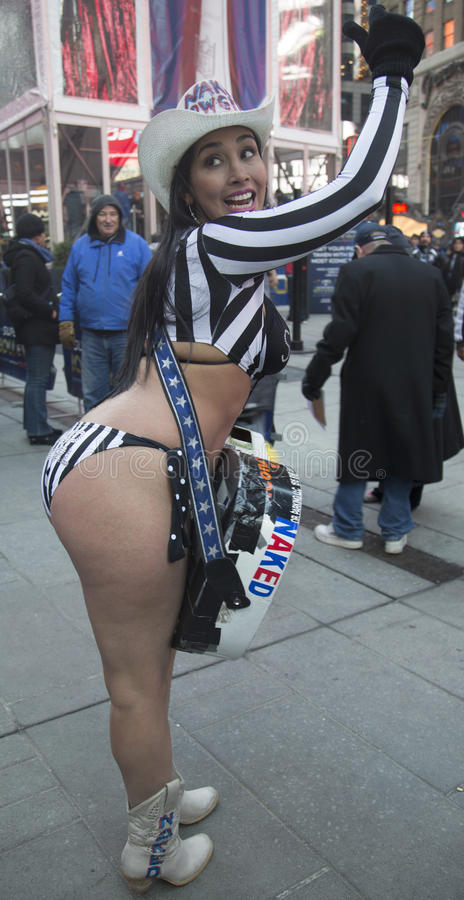 Alex, the Naked Cowgirl, entertains the crowd in Times Square during Super Bowl XLVIII week in Manhattan stock photography
