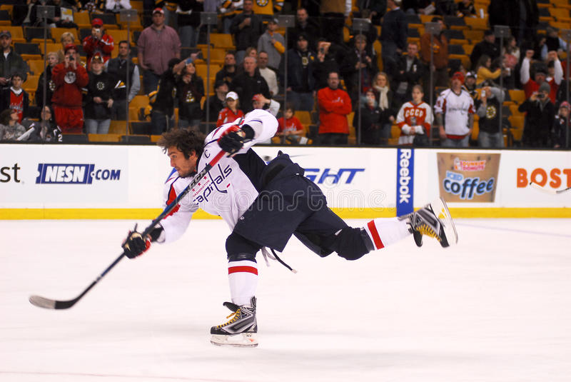 Alex Ovechkin. Boston Fans look on as Washington Capitals Superstar Alex Ovechkin rips a slapshot during pre-game warm-up stock photo