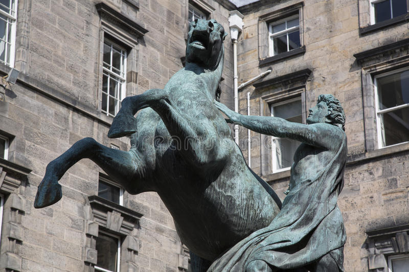 Alexander and Bucephalus Statue by Steell, City Chambers on Royal Mile Street; Edinburgh royalty free stock photos