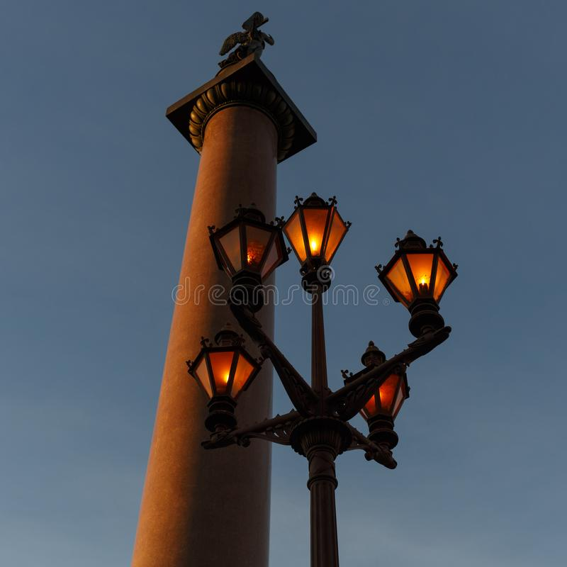Alexander Column and working flashlight at Palace Square in Saint Petersburg. Russia. stock photos